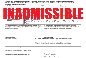 the words inadmissible stamped in red over application for immigrant visa and alien registration